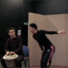 Man playing drum and woman dancing
